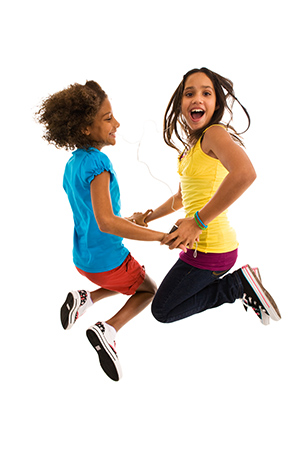 girls dancing and jumping in mid-air
