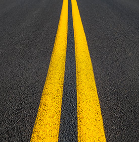 parallel yellow stripes on road