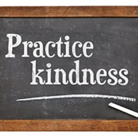 Practice kindness - inspirational advice on a vintage slate blackboard